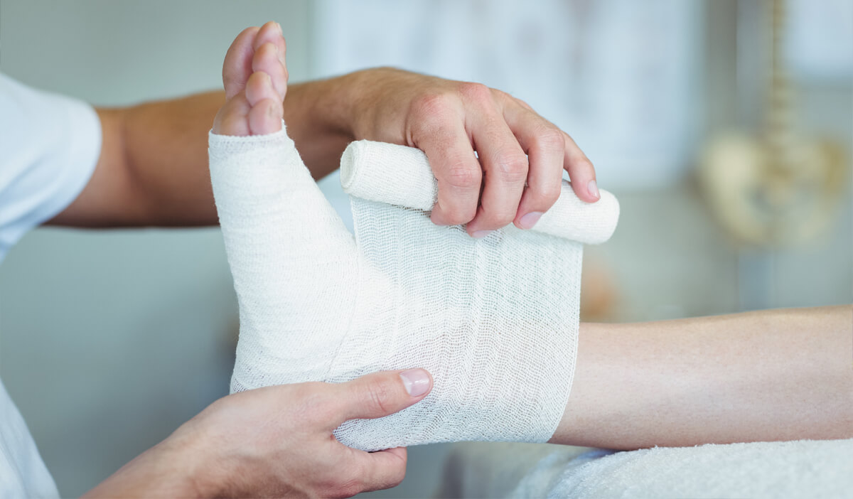 Wound care specialist bandages a wound that won't heal