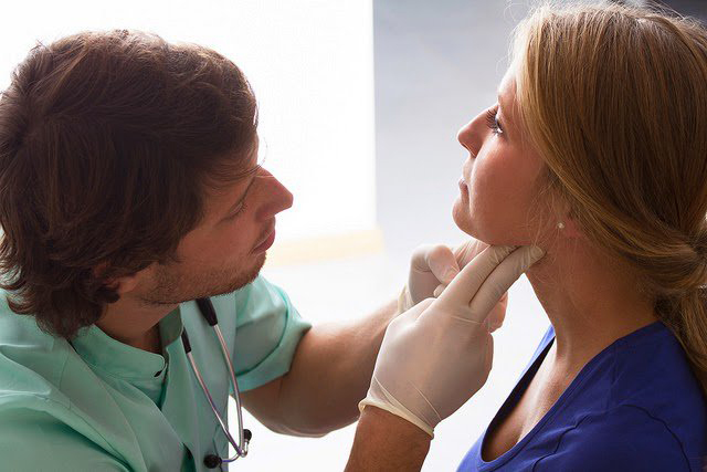 provider takes care of patient at annual doctor checkup appointment