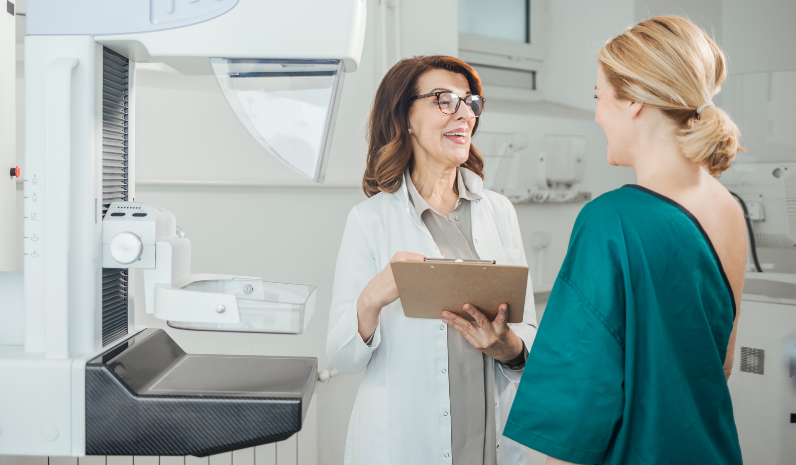 a doctor chats with her breast cancer patient after she had a mammogram