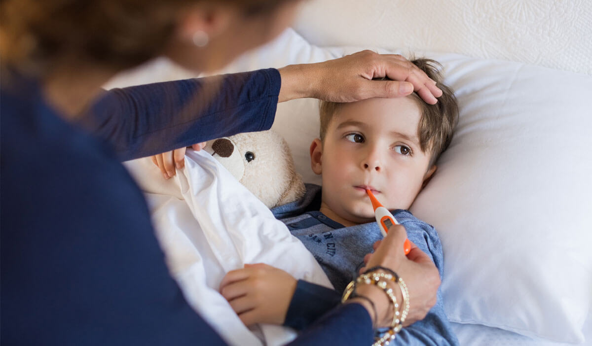 mom uses a thermometer to measure her child's fever