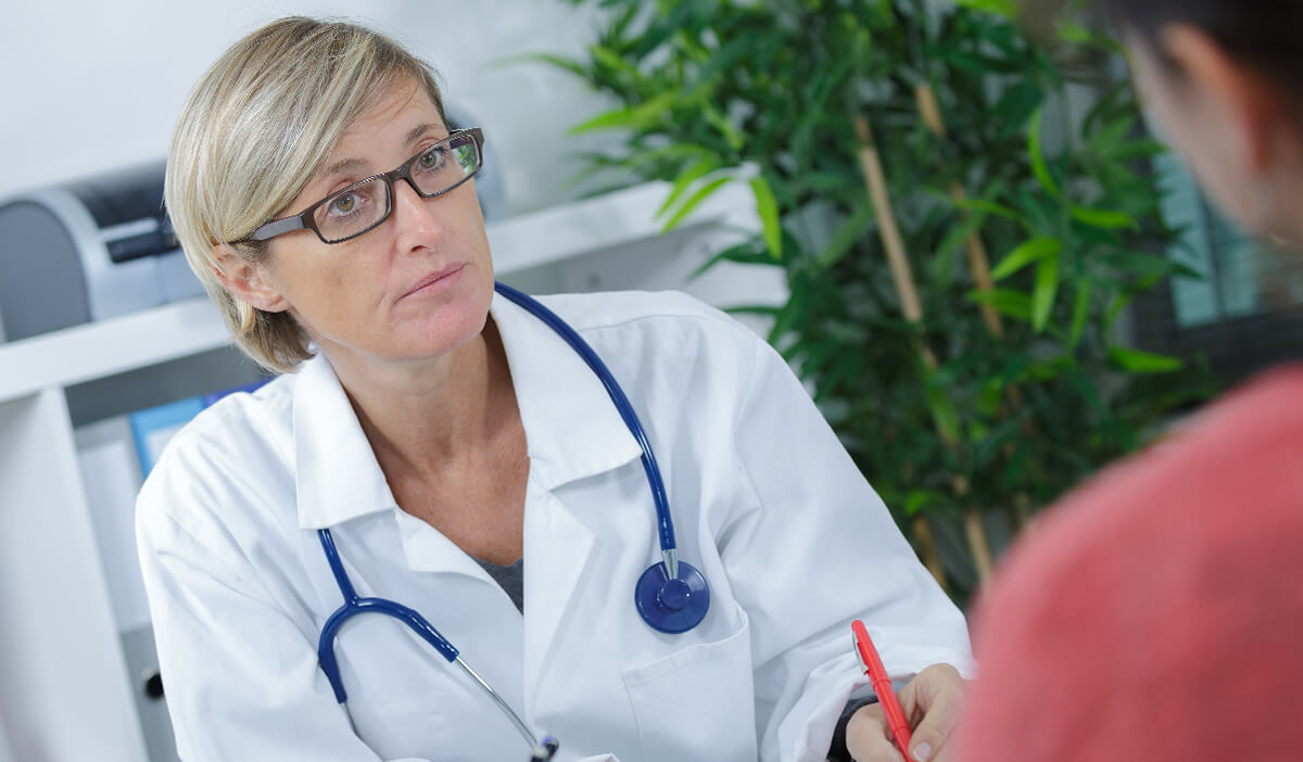 An OB/GYN doctor talks to her patient about women's health services