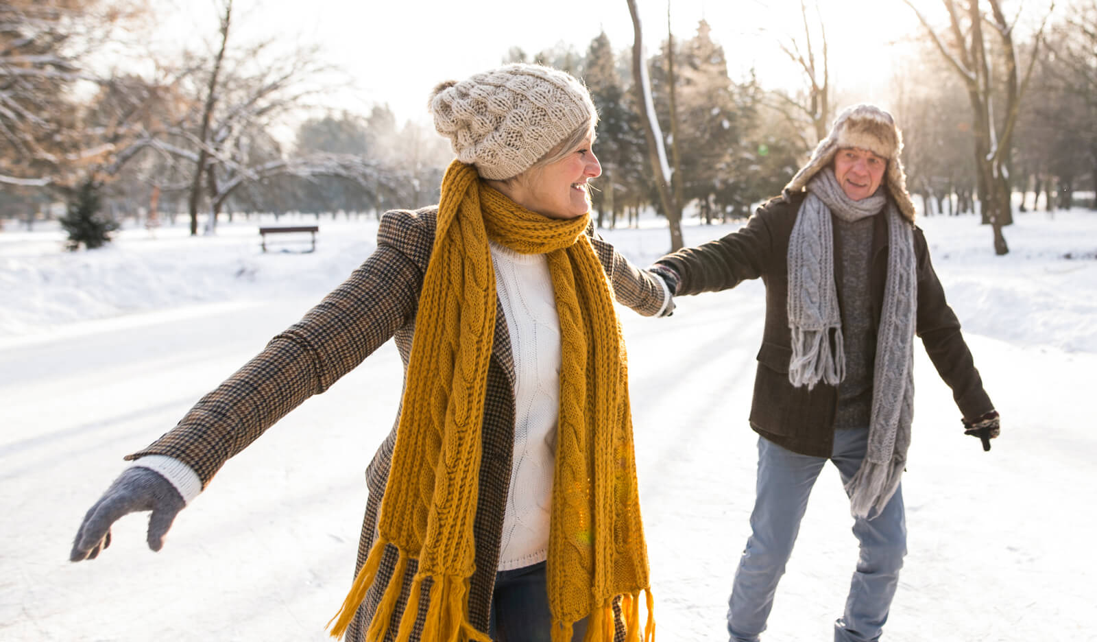 Older couple exercises outside in the snow