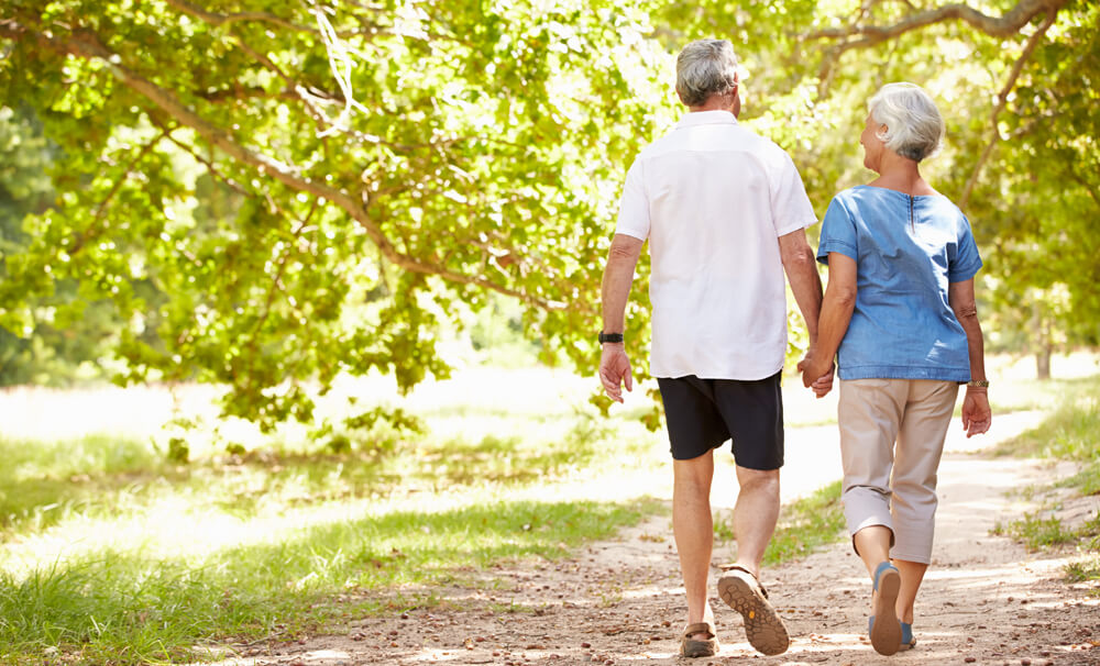 Seniors walking without pain after hip replacement surgery