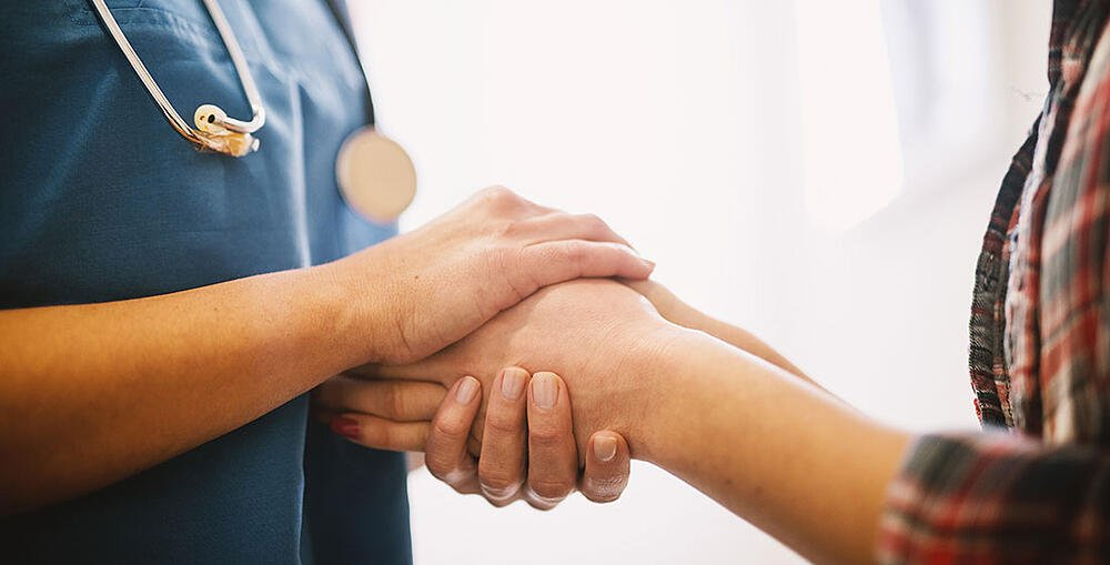 doctor-holding-patient-hand-1