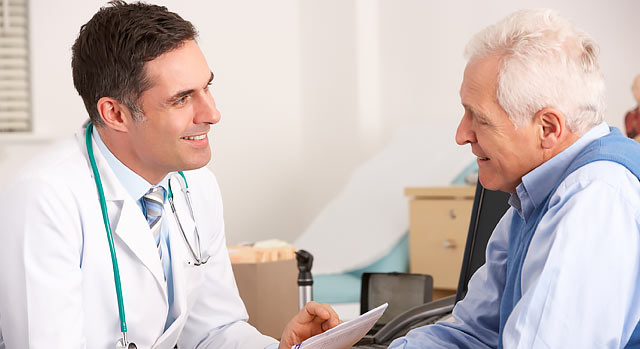 A urologist discusses PSA results with a patient