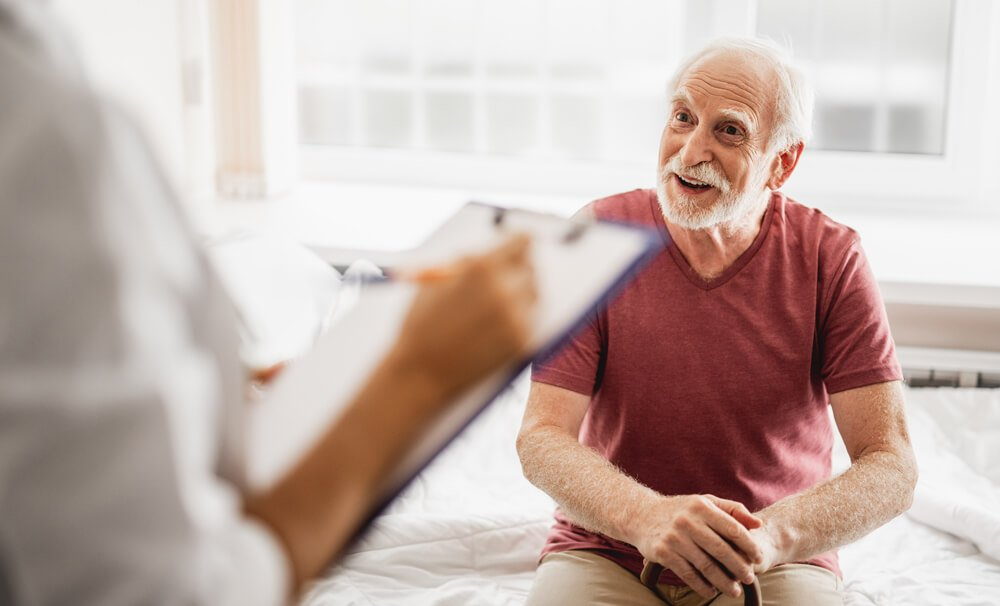 older-patient-talking-with-a-doctor-before-a-colonoscopy